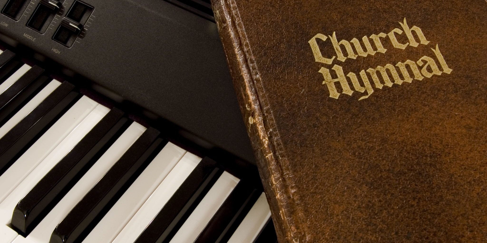 bigstock-Hymnal-And-Keyboard-890286