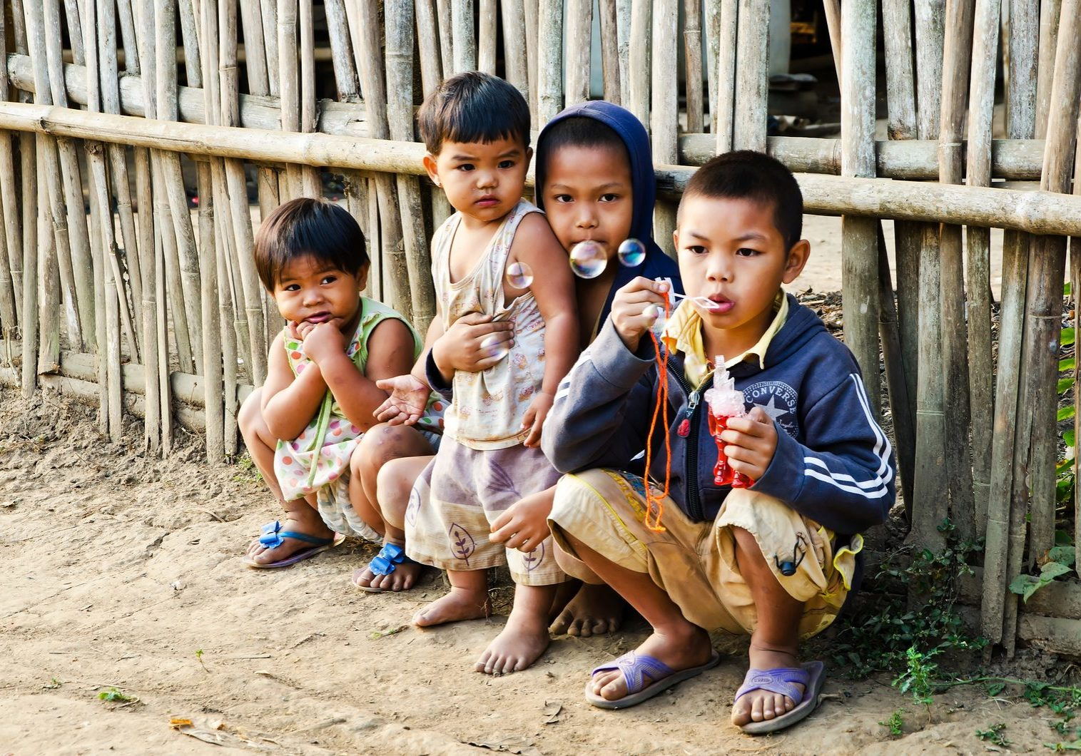 KANCHANABURI THAILAND-January 29: An unidentified Mon children 5-12 years old playing with bubbles on January 29 2012 at KANCHANABURI THAILAND. Mon are an ethnic group spread in Thailand.